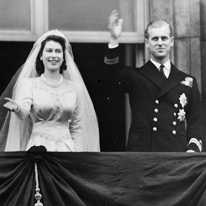 Princess Elizabeth and The Prince Philip, Duke of Edinburgh waving to a crowd from the balcony of Buckingham Palace, London shortly after their wedding at Westminster Abbey.