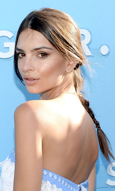 Emily Ratajkowski turned heads with a low plaited ponytail, leaving her front tresses loose for laidback elegance.