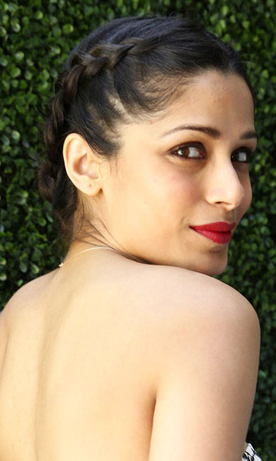 Freida Pinto turned heads with this elegant braided updo with a middle parting – team with statement red lips to recreate her laidback glamorous style.