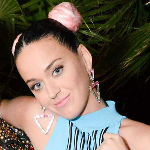 Katy Perry turned heads at a party hosted by Moschino designer Jeremy Scott when she arrived with her glossy black tresses slicked back into two hair buns – each dyed a bold candyfloss-pink for a striking finish.