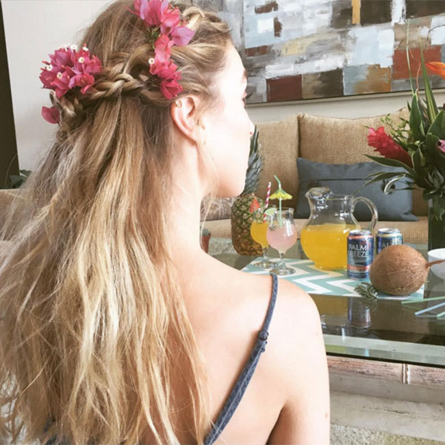 Whitney Port mixed two festival classic beauty looks, opting for a braid and floral crown to complement her loose wavy hair for ultimate boho chic.