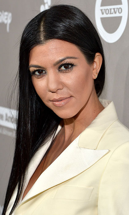 Kourtney wowed at the Baby2Baby gala, not only with her elegant cream ensemble, but with the simple yet striking beauty look she chose, consisting of long sleek tresses and bold eyeliner.