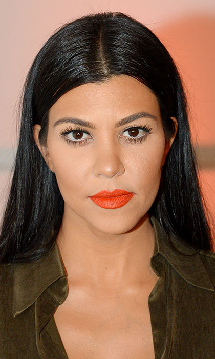 Take a leaf out of Kourtney's book and try a statement lip with a twist by opting for a bold coral shade rather than a classic red.