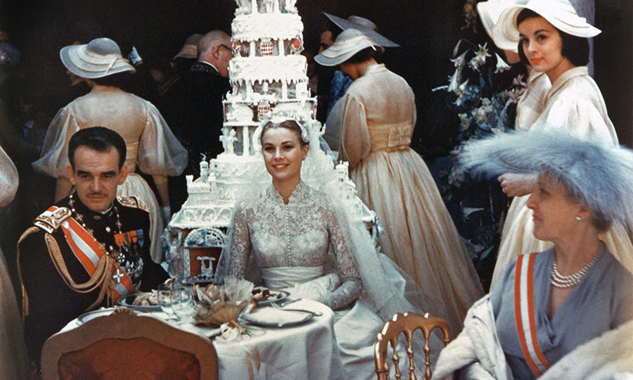 <p>Rainier and Grace enjoyed their wedding luncheon at the Palace's Court of Honour attended by 700 guests, and later cut their six-tier wedding cake using the prince's sword.</p>