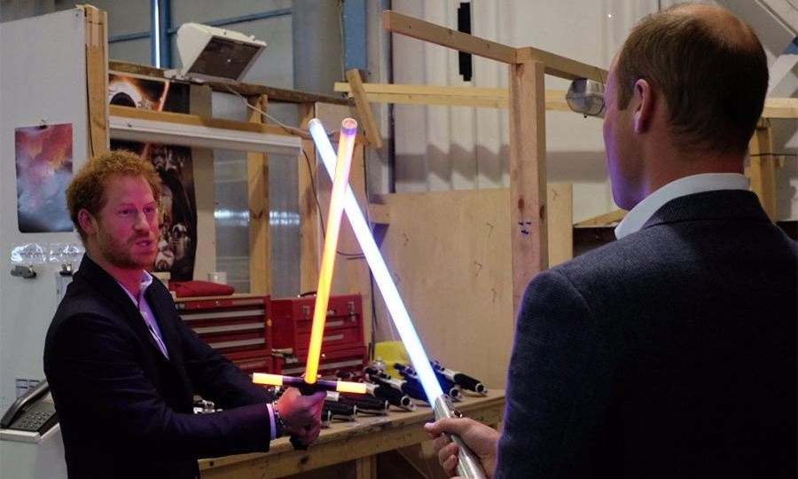 Princes William and Harry had a playful lightsaber battle during their tour of the Star Wars set.