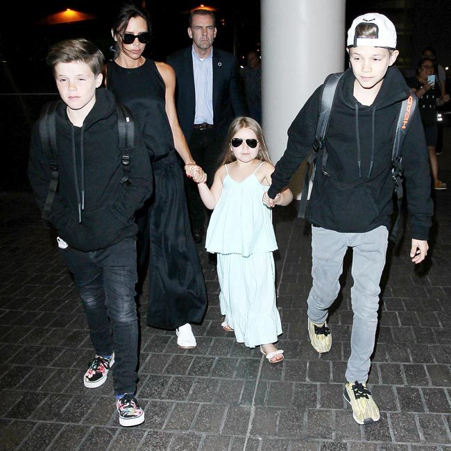 Leaving the airport in April 2016, the adorable four-year-old was armed with Victoria's fashion staple – oversized sunglasses.