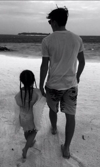 Brooklyn Beckham enjoyed some special bonding time with his sister Harper while on an exotic family getaway. Harper rocked trendy braids and a caftan for their stroll on the beach.