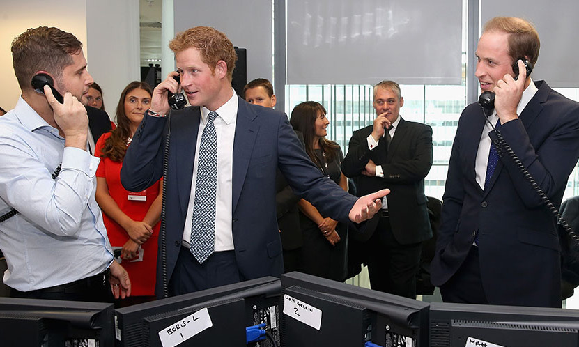 One phone call away: Wills and Harry tried their hand at trading during the BGC Charity Day.