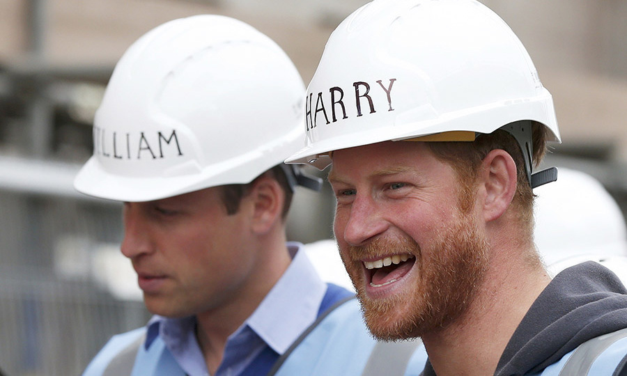 William and Harry showed of their personalized hats during a tour of a building site for the BBC television DIY SOS series in Manchester.