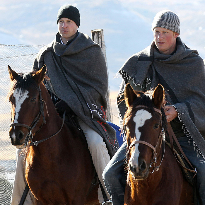 Horsing around! William and Harry enjoyed a ride together during their visit to Semonkong, Lesotho.