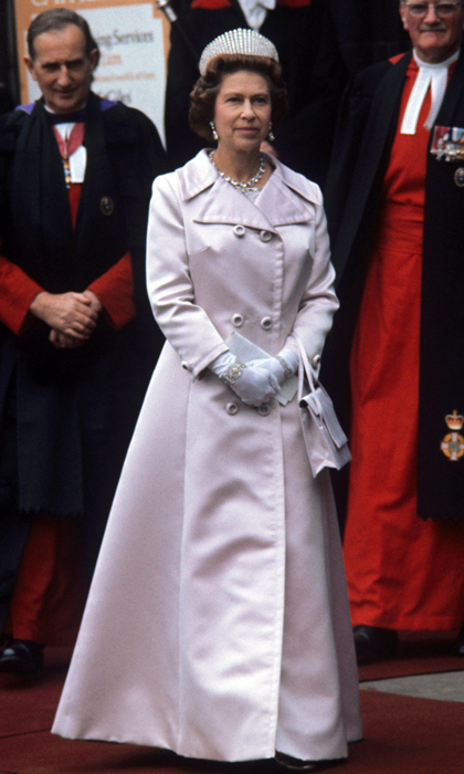 White gloves are her signature accessory, with watches and bracelets on display over the top of her covered wrists. 
