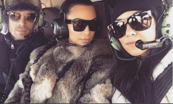 The famous sisters made their fans envious by revealing they had taken a helicopter ride to the top of a glacier.