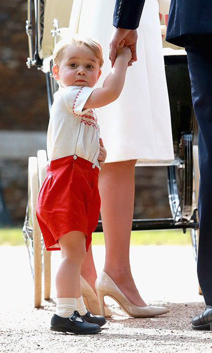 Prince George wore a smocked set of red shorts and embroidered shirt by the British designer Rachel Riley.