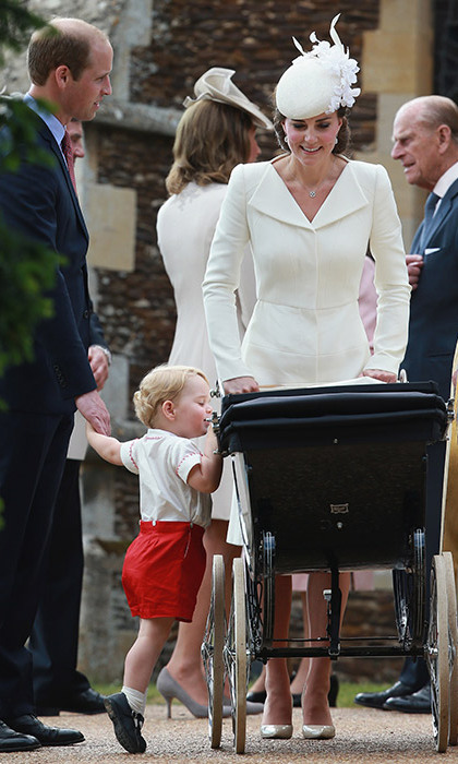Prince George couldn't help but peek over the pram to catch a glimpse of his baby sister.