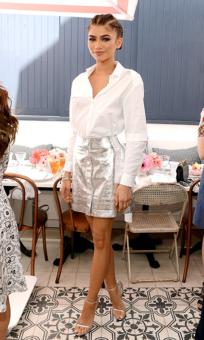 Zendaya channels Sunday brunch chic in a white Manning Cartell button-down shirt and metallic skirt at <em>Glamour</em>'s Game Changers Lunch in Los Angeles.