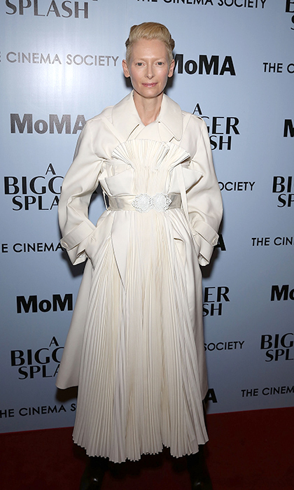 The impossibly regal Tilda Swinton is swathed in an off-white Maison Margiela Artisanal coat at the New York premiere of her film <em>A Bigger Splash</em>