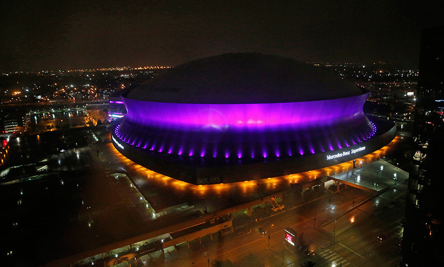 The Mercedes-Benz Superdome is lit up in the colour purple in New Orleans to honour pop legend Prince.