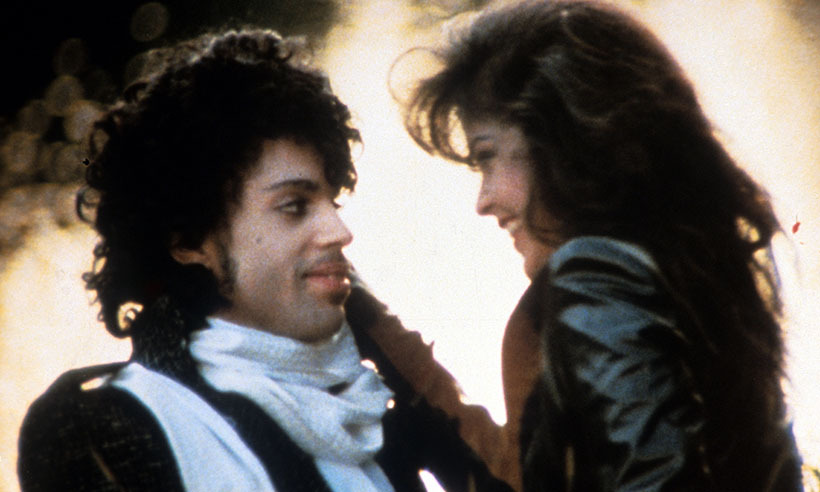 <p>In a scene from his iconic 1984 film <em>Purple Rain</em>, Prince embraces his longtime collaborator and lover Apollonia Kotero. The film was the culmination of his chart-topping album <em>Purple Rain</em>, a cult favourite loosely based on the singer's life and through which he won an Oscar and also simultaneously achieved the number-one album, single and movie on US charts.</p>