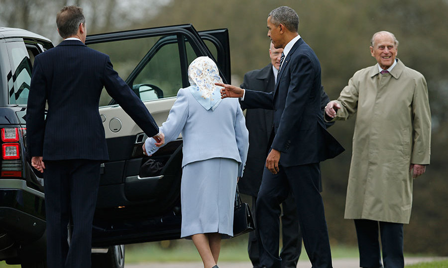 President Barack Obama, the Queen and Prince Phillip, right, get into a car after after arriving at Windsor Castle for a private lunch in Windsor.