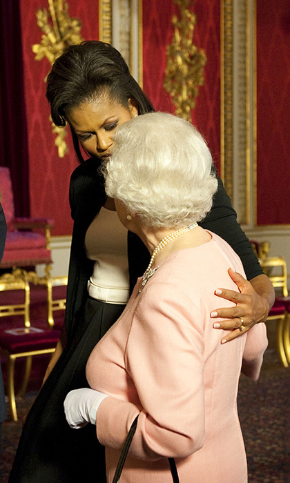 In 2009 Michelle broke royal protocol and put her arm around the Queen – only to have the monarch return the gesture and hug her back.