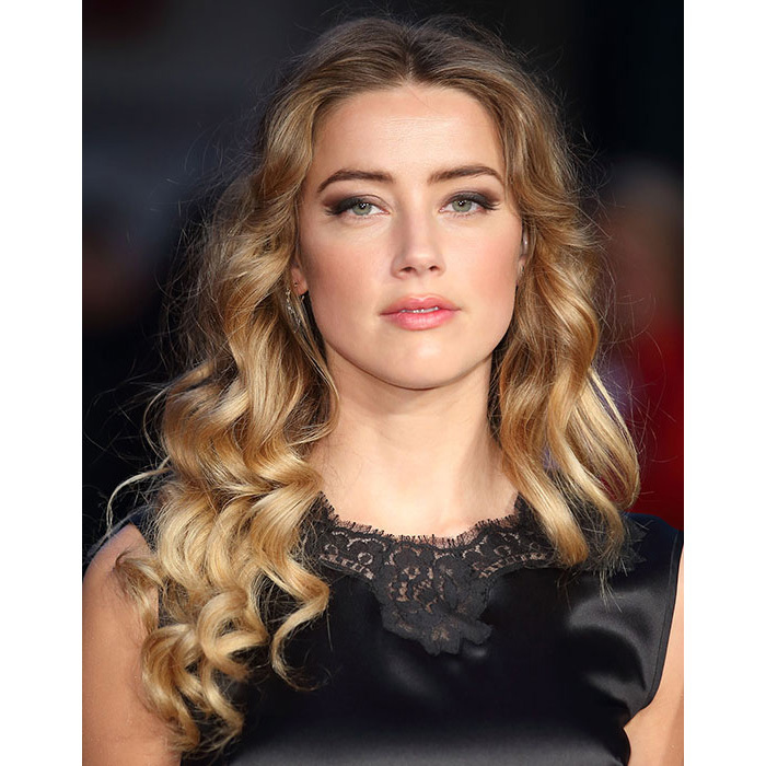 All eyes were on the blonde beauty as she arrived for the premiere of <em>Black Mass</em>, where her hair was left down in cascading, voluminous curls, with grey smokey eyeshadow and a hint of vibrant pink lipstick.