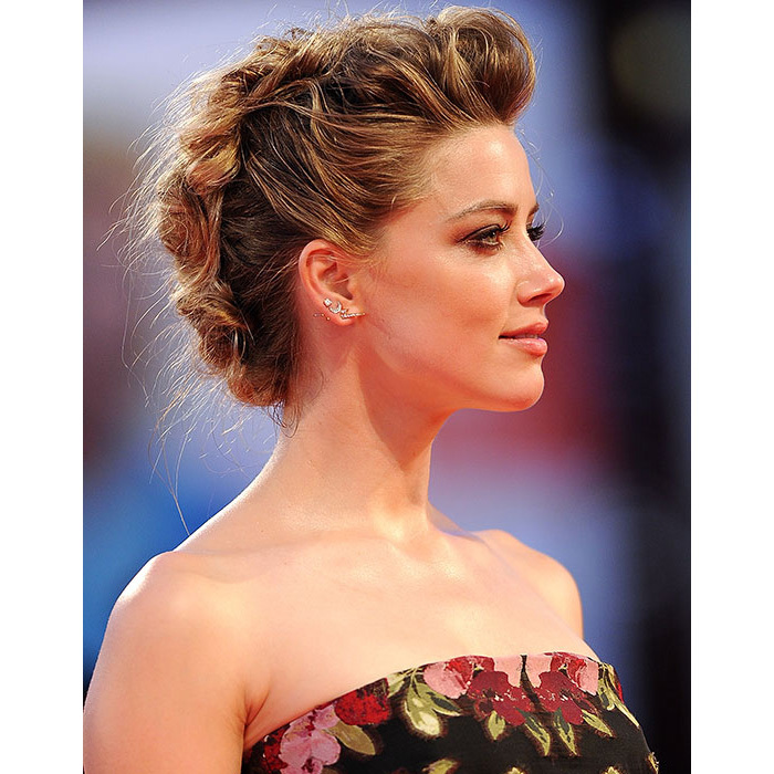 The <em>Alpha Dog</em> star had jaws dropping to the floor as she hit the Venice Film Festival with this edgy updo, with heaps of volume at the roots and braid detailing.
