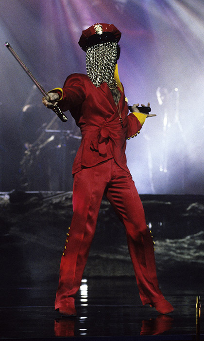 "Prince donned an over-the-top ensemble while taking the stage in New York in 1993, obscuring his face with chains and brandishing a sword. This was the year that he became The Artist Formerly Known As Prince after changing his name to ""the love symbol"" (Ƭ̵̬̊) - and releasing his popular record <em>The Love Symbol Album</em>.