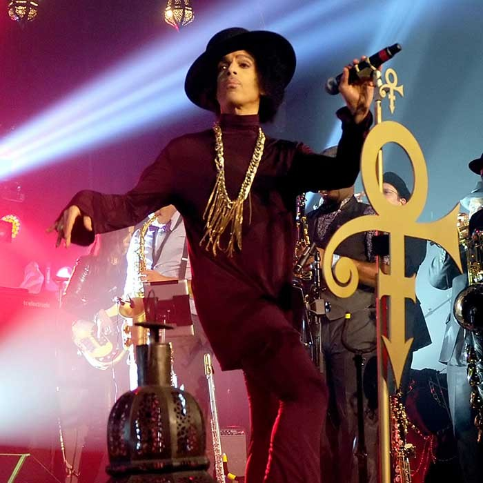With his iconic symbol in full force, Prince looked the epitome of a cool cat at the Hollywood Palladium in Los Angeles in 2014. 