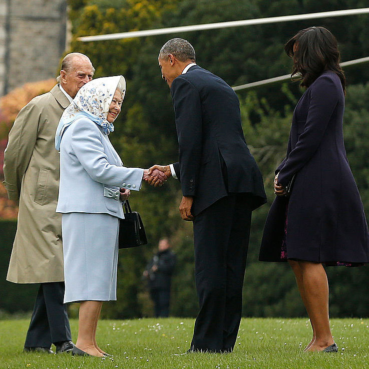 Dressed in pale blue, Her Majesty warmly greeted the Obamas on her Berkshire estate with her husband by her side.