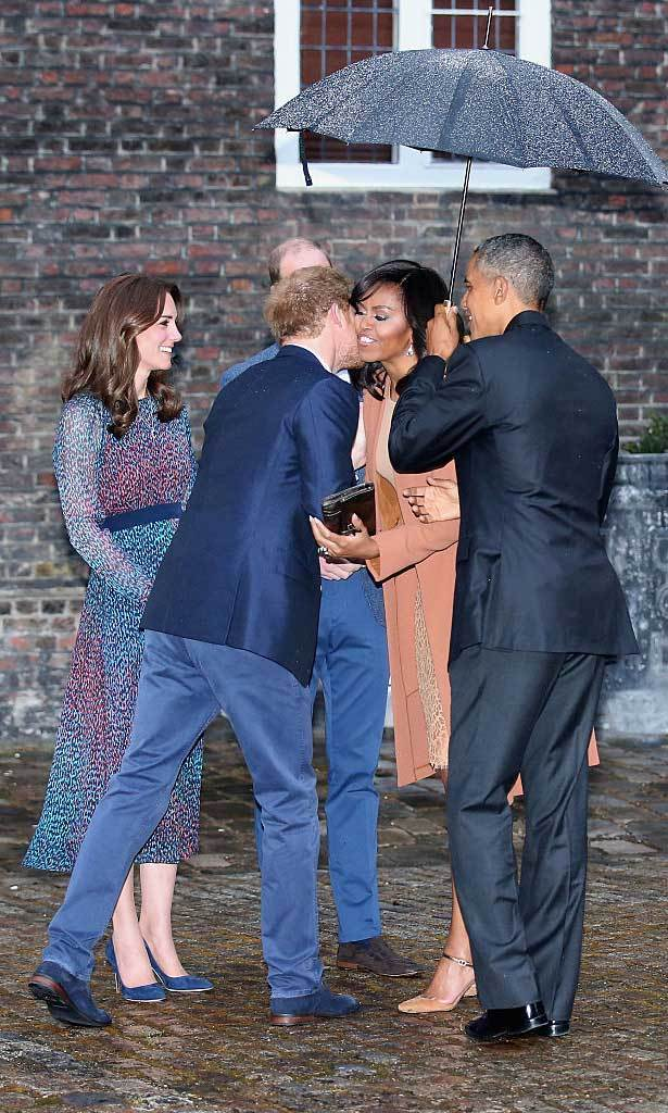 Harry greeted his American pal, Michelle Obama, with a kiss. The two will be reuniting in May for the royal's upcoming Invictus Games.