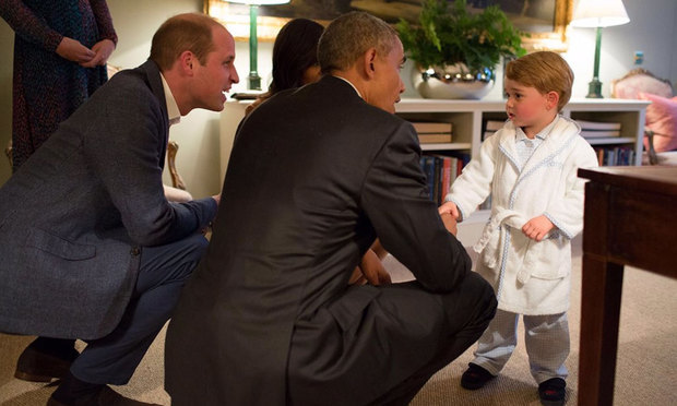 A little world leader in the making, Prince George shakes hands with President Obama while dressed in his robe and slippers. Just because it's past your bedtime, doesn't mean you pass up an opportunity like this!