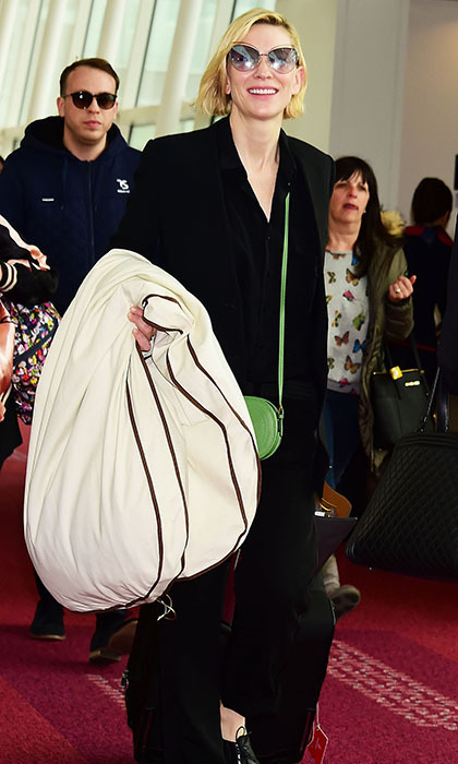 Cate Blanchett looked impossibly chic arriving at Tokyo's Haneda Airport, where she attended a party for Louis Vuitton. Cue a rush of women buying all-black suiting...