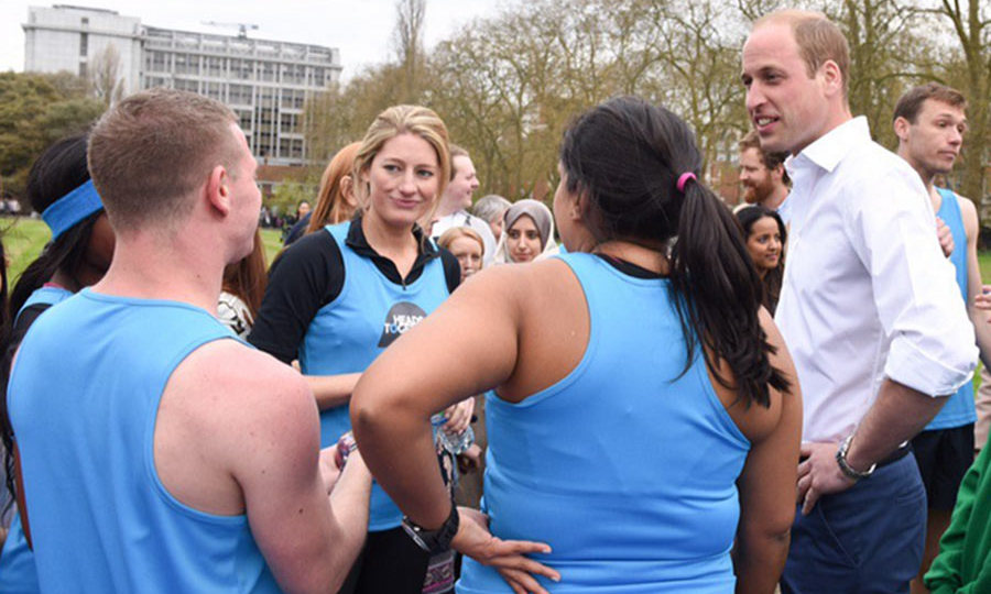 The royal trio chatted to charity workers.