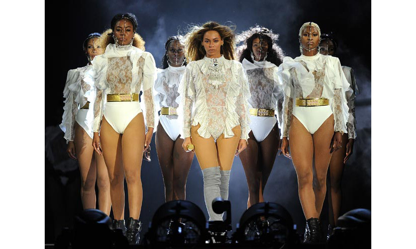 <p>Beyoncé kicked things off in a beautiful white leotard from Balmain that was covered in white ruffles. She paired the bodysuit with thigh-high grey boots.</p>Photo: © Rex