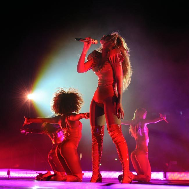 <p>A red latex bodysuit showed off her incredible figure.</p>Photo: © Rex
