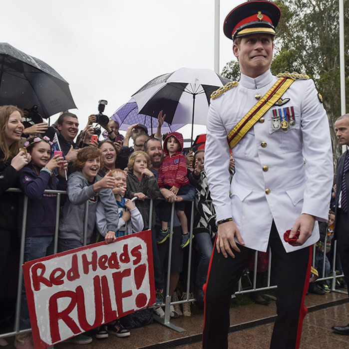 "Prince Harry had crowds laughing as he pulled a silly face after seeing a sign which read: ""red heads rule,"" jokily referring to Harry's hair.<br>The Prince greeted members of the public outside the Australian War Memorial during an official visit prior to the end of his military career in 2015.<br>Photo: © Getty Images"