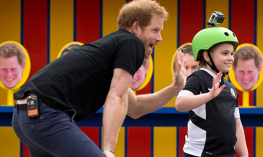 "While visiting a school for Sky Sports TV show <em>Gamechangers</em>, Harry joined in on the fun when children had to throw balls at targets with Harry's face printed on them.<br>Co-presenter Darren Campbell commented on how well Harry had done at the school, saying: ""When you are doing a kids' TV show, the children know when somebody's fake and not there for the right reasons. They know Prince Harry was there for the right reasons. It will be a day those young people won't forget.""<br>Photo: © Getty Images"