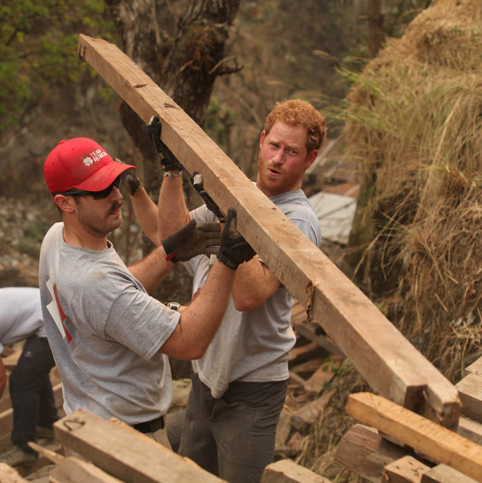 Harry enjoyed his visit to Nepal so much that he extended his stay to help Team Rubicon rebuild a village in Lapubesi after last year's earthquake. The Prince showed his work ethic by clearing wood for a solar farm site.<br>Photo: © Getty Images