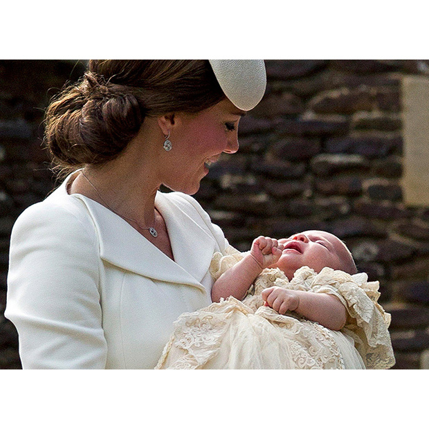 Taken shortly before the christening, Kate beams down at her little girl.