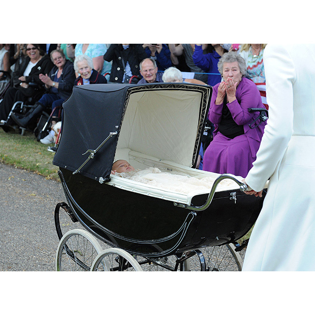 Princess Charlotte's christening took place on July 5 2015 at the Church of St Magdalene on the Queen's Sandringham Estate. Doting mom Kate takes Charlotte past the hundreds of well-wishers gathered outside.