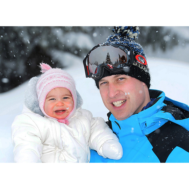 Proud dad Prince William cuddles up to his little girl as they pose in the snow on Mar. 3 2016.