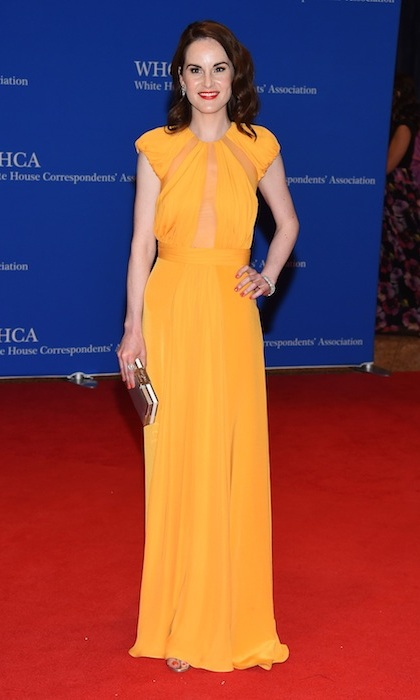 Downton Abbey star Michelle Dockery's stunning yellow gown perfectly complemented her pale skin and dark hair.