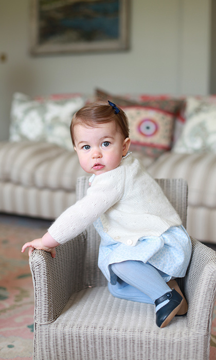 In a series to mark her first birthday, Princess Charlotte played at the Cambridge's Anmer Hall home while mom Kate snapped away. The adorable royal wore two outfits, one pink and one blue, and starred in shots taken both indoors and outside. 