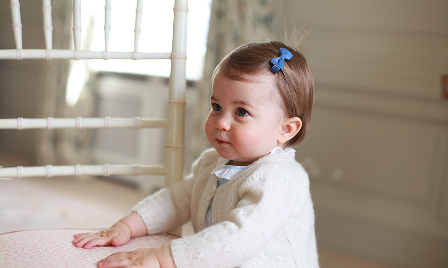 Little Charlotte perfects her profile pose in one of four new birthday portraits. 
