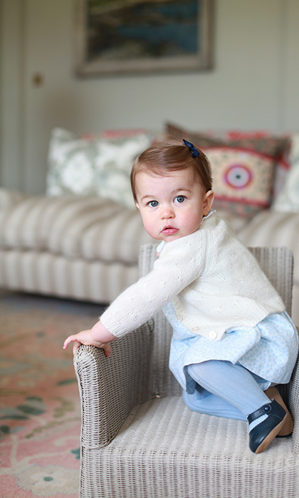 Those cheeks! The adorable youngster poses in Anmer Hall.  