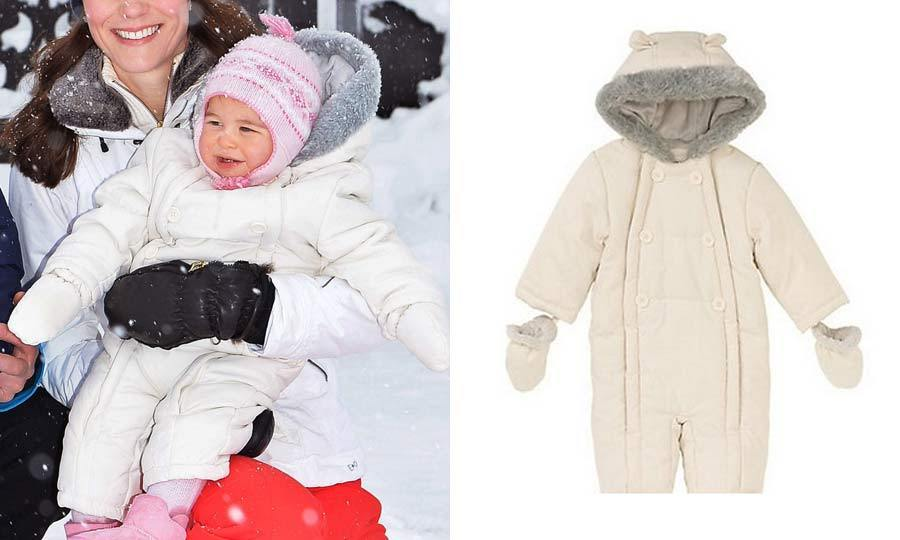 Baby's first snow outfit! Even on the slopes Charlotte looked stylish wearing a $41 off-white John Lewis Baby Wadded Snowsuit. Kate made sure the little one kept her head warm in a sweet pink and white hat.<br>Photo: © Getty Images/johnlewis.com