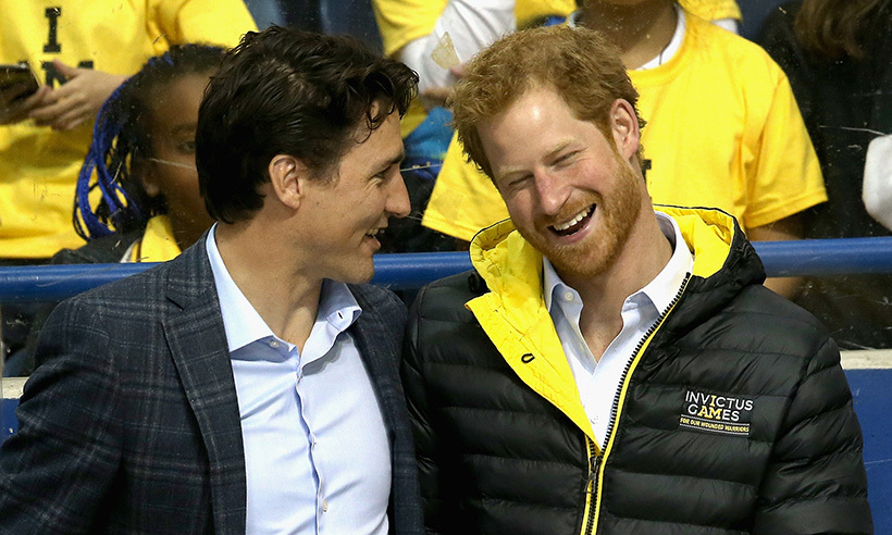 Justin Trudeau shares a laugh with Prince Harry during a sledge hockey game at Ryerson University.<br>Photo: © Chris Jackson/Getty Images