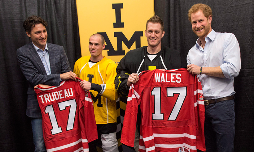 The prime minister and Prince Harry received personalized jerseys before Canada's national sledge hockey team showed off their skills at Ryerson University.<br>Photo: © Nathan Denette/CP