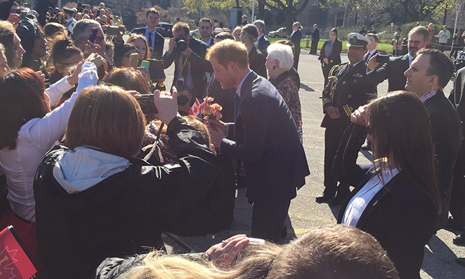 Always the gentleman, Prince Harry stopped to thank a young fan for flowers before posing for a selfie.<br>Photo: © Clare Douglas