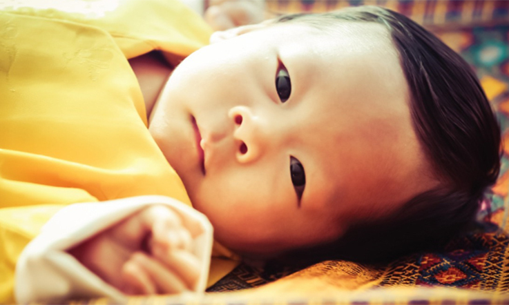 Bhutan's baby prince shows off a full head of hair in the new image. 